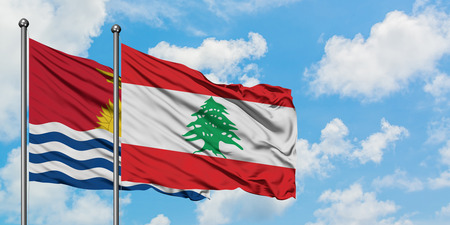 Kiribati and Lebanon flag waving in the wind against white cloudy blue sky together. Diplomacy concept, international relations. 版權商用圖片