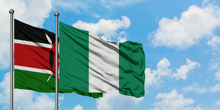 Kenya and Nigeria flag waving in the wind against white cloudy blue sky together. Diplomacy concept, international relations.