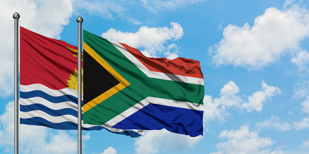 Kiribati and South Africa flag waving in the wind against white cloudy blue sky together. Diplomacy concept, international relations.