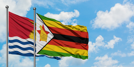 Kiribati and Zimbabwe flag waving in the wind against white cloudy blue sky together. Diplomacy concept, international relations.