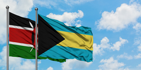 Kenya and Bahamas flag waving in the wind against white cloudy blue sky together. Diplomacy concept, international relations.