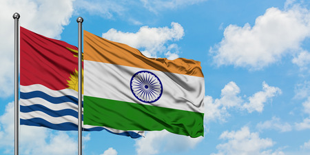 Kiribati and India flag waving in the wind against white cloudy blue sky together. Diplomacy concept, international relations.