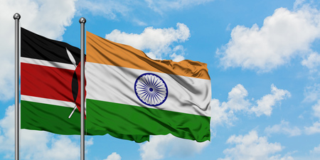 Kenya and India flag waving in the wind against white cloudy blue sky together. Diplomacy concept, international relations.