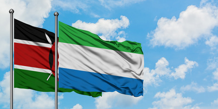 Kenya and Sierra Leone flag waving in the wind against white cloudy blue sky together. Diplomacy concept, international relations. Stock Photo