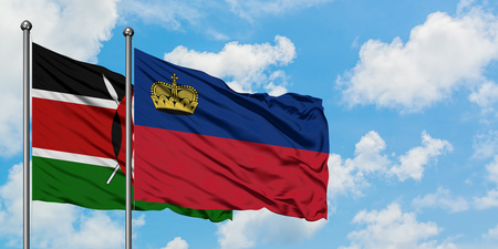 Kenya and Liechtenstein flag waving in the wind against white cloudy blue sky together. Diplomacy concept, international relations. Stock Photo