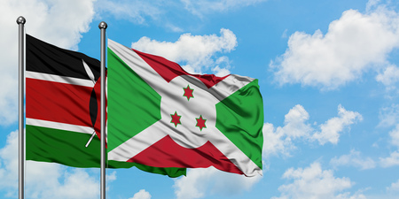 Kenya and Burundi flag waving in the wind against white cloudy blue sky together. Diplomacy concept, international relations.