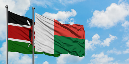 Kenya and Madagascar flag waving in the wind against white cloudy blue sky together. Diplomacy concept, international relations.