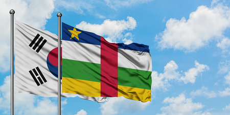 South Korea and Central African Republic flag waving in the wind against white cloudy blue sky together. Diplomacy concept, international relations.