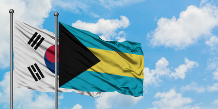 South Korea and Bahamas flag waving in the wind against white cloudy blue sky together. Diplomacy concept, international relations. Stock Photo - 123794015