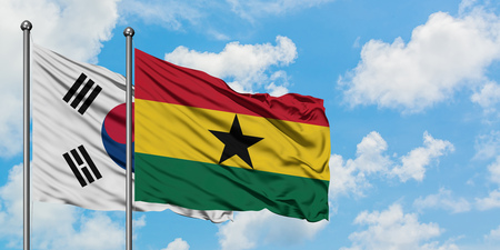 South Korea and Ghana flag waving in the wind against white cloudy blue sky together. Diplomacy concept, international relations. Imagens