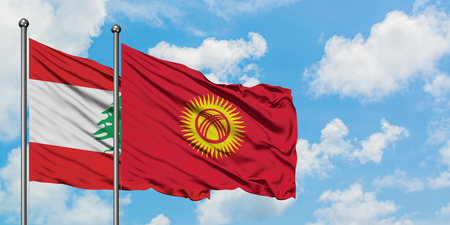Lebanon and Kyrgyzstan flag waving in the wind against white cloudy blue sky together. Diplomacy concept, international relations.