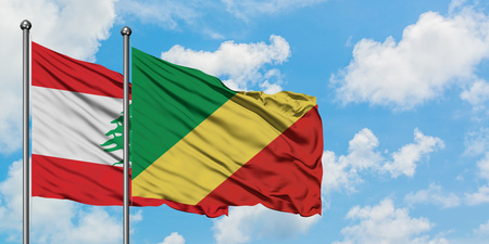 Lebanon and Republic Of The Congo flag waving in the wind against white cloudy blue sky together. Diplomacy concept, international relations.