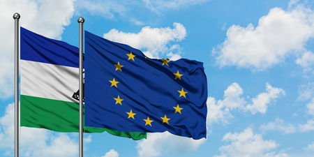 Lesotho and European Union flag waving in the wind against white cloudy blue sky together. Diplomacy concept, international relations.