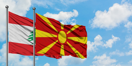 Lebanon and Macedonia flag waving in the wind against white cloudy blue sky together. Diplomacy concept, international relations. Banco de Imagens
