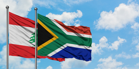 Lebanon and South Africa flag waving in the wind against white cloudy blue sky together. Diplomacy concept, international relations.