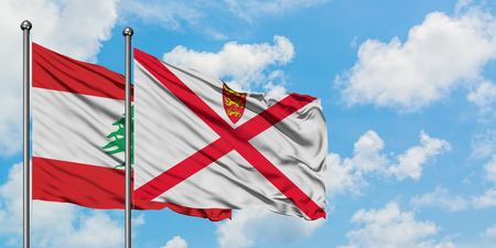 Lebanon and Jersey flag waving in the wind against white cloudy blue sky together. Diplomacy concept, international relations.