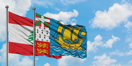 Lebanon and Saint Pierre And Miquelon flag waving in the wind against white cloudy blue sky together. Diplomacy concept, international relations.