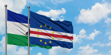 Lesotho and Cape Verde flag waving in the wind against white cloudy blue sky together. Diplomacy concept, international relations.