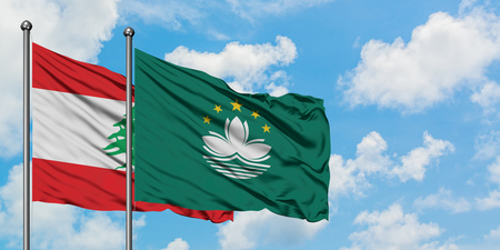 Lebanon and Macao flag waving in the wind against white cloudy blue sky together. Diplomacy concept, international relations.