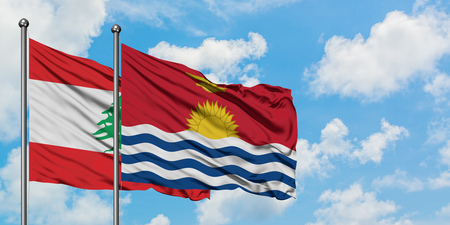 Lebanon and Kiribati flag waving in the wind against white cloudy blue sky together. Diplomacy concept, international relations.