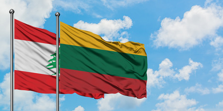 Lebanon and Lithuania flag waving in the wind against white cloudy blue sky together. Diplomacy concept, international relations.