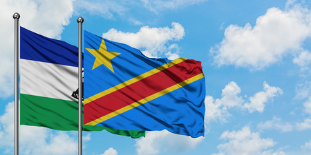 Lesotho and Congo flag waving in the wind against white cloudy blue sky together. Diplomacy concept, international relations.