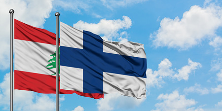 Lebanon and Finland flag waving in the wind against white cloudy blue sky together. Diplomacy concept, international relations.