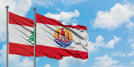 Lebanon and French Polynesia flag waving in the wind against white cloudy blue sky together. Diplomacy concept, international relations. Banco de Imagens