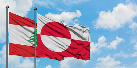 Lebanon and Greenland flag waving in the wind against white cloudy blue sky together. Diplomacy concept, international relations.