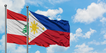 Lebanon and Philippines flag waving in the wind against white cloudy blue sky together. Diplomacy concept, international relations.