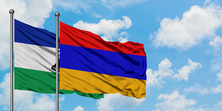 Lesotho and Armenia flag waving in the wind against white cloudy blue sky together. Diplomacy concept, international relations.