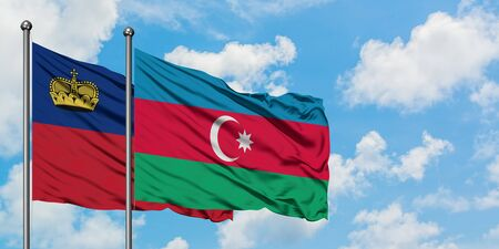 Liechtenstein and Azerbaijan flag waving in the wind against white cloudy blue sky together. Diplomacy concept, international relations.