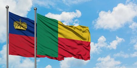 Liechtenstein and Benin flag waving in the wind against white cloudy blue sky together. Diplomacy concept, international relations.