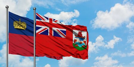 Liechtenstein and Bermuda flag waving in the wind against white cloudy blue sky together. Diplomacy concept, international relations. Imagens