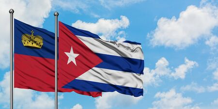 Liechtenstein and Cuba flag waving in the wind against white cloudy blue sky together. Diplomacy concept, international relations.
