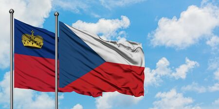 Liechtenstein and Czech Republic flag waving in the wind against white cloudy blue sky together. Diplomacy concept, international relations.