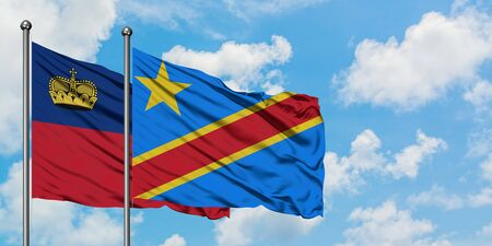 Liechtenstein and Congo flag waving in the wind against white cloudy blue sky together. Diplomacy concept, international relations.