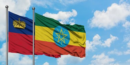 Liechtenstein and Ethiopia flag waving in the wind against white cloudy blue sky together. Diplomacy concept, international relations.