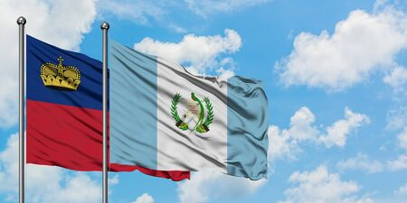 Liechtenstein and Guatemala flag waving in the wind against white cloudy blue sky together. Diplomacy concept, international relations.