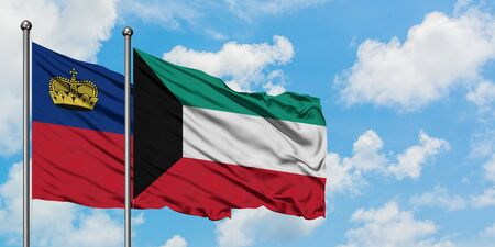 Liechtenstein and Kuwait flag waving in the wind against white cloudy blue sky together. Diplomacy concept, international relations.