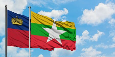 Liechtenstein and Myanmar flag waving in the wind against white cloudy blue sky together. Diplomacy concept, international relations.