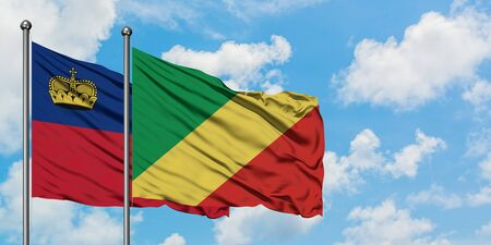 Liechtenstein and Republic Of The Congo flag waving in the wind against white cloudy blue sky together. Diplomacy concept, international relations.
