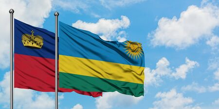 Liechtenstein and Rwanda flag waving in the wind against white cloudy blue sky together. Diplomacy concept, international relations. Foto de archivo