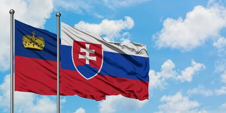 Liechtenstein and Slovakia flag waving in the wind against white cloudy blue sky together. Diplomacy concept, international relations.