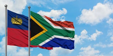 Liechtenstein and South Africa flag waving in the wind against white cloudy blue sky together. Diplomacy concept, international relations.