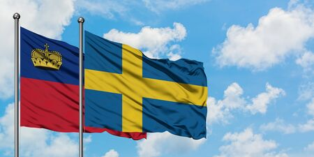 Liechtenstein and Sweden flag waving in the wind against white cloudy blue sky together. Diplomacy concept, international relations.