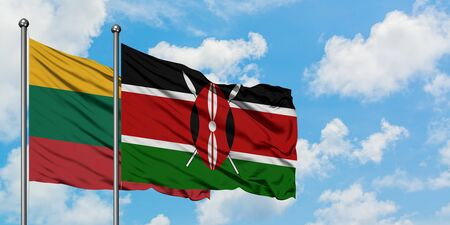 Lithuania and Kenya flag waving in the wind against white cloudy blue sky together. Diplomacy concept, international relations. Stock Photo