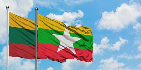 Lithuania and Myanmar flag waving in the wind against white cloudy blue sky together. Diplomacy concept, international relations.