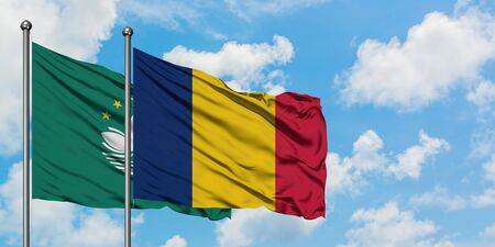 Macao and Chad flag waving in the wind against white cloudy blue sky together. Diplomacy concept, international relations.