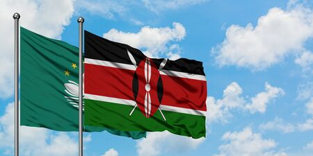 Macao and Kenya flag waving in the wind against white cloudy blue sky together. Diplomacy concept, international relations.